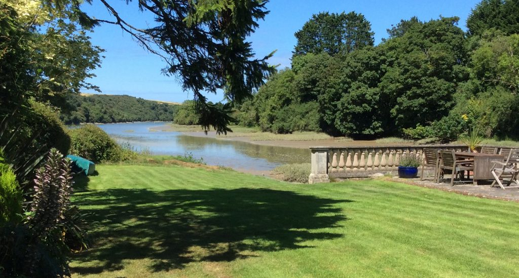 Dine alfresco in the beautiful garden, surrounded by the estuary